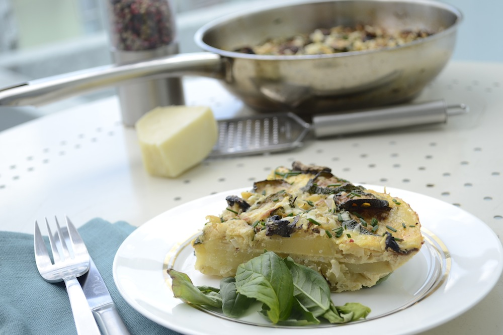 spanish omelette, omelette with herbs, spanish tortilla, tortilla on plate, parmesan and pepper,
